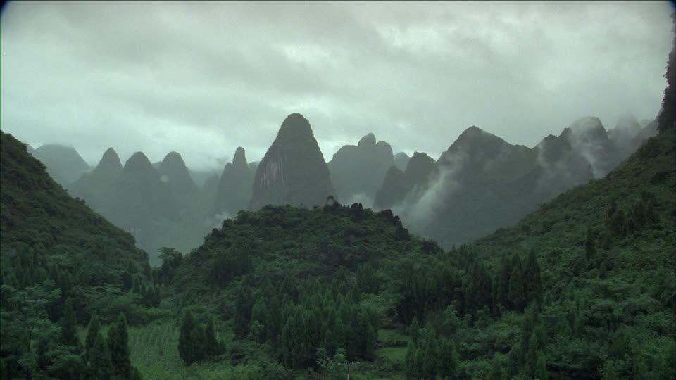 539585262-guangxi-zhuang-waft-of-mist-karst-forest.jpg